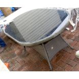 A glass top conservatory/patio table