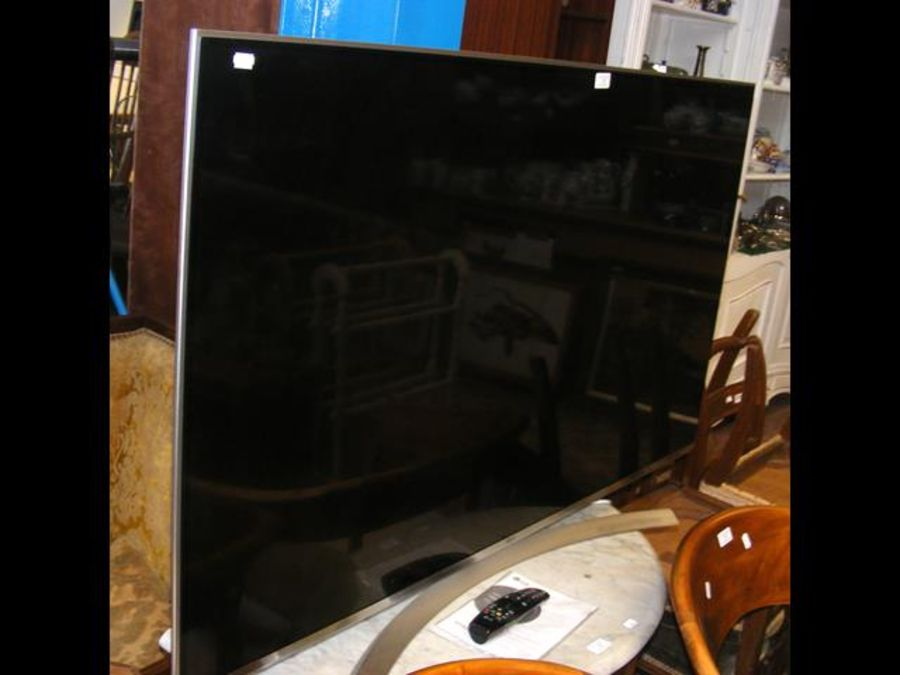 An LG 55'' flat screen TV with remote and owner's ma