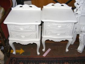 The matching pair of bedside chests