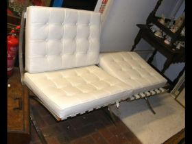 A retro style chrome and leather X-frame chair wit