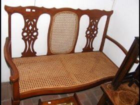 Early 20th century two seater cane work settee wit