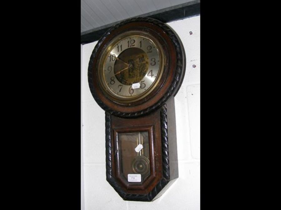 A 1920's wall clock with gadrooned edging