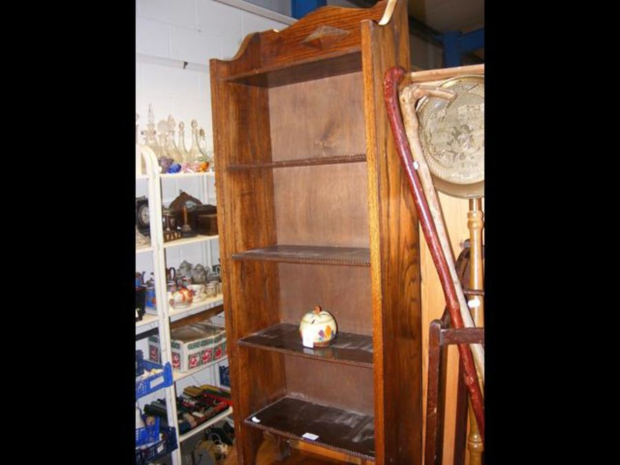 A narrow oak bookcase with five shelves - width 45