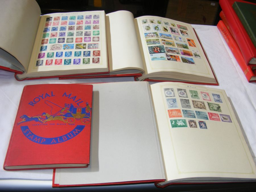 Four albums containing collectable stamps includin