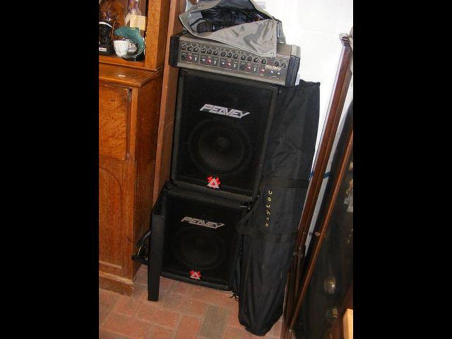 A PA system with Peavey speakers and stands, toget