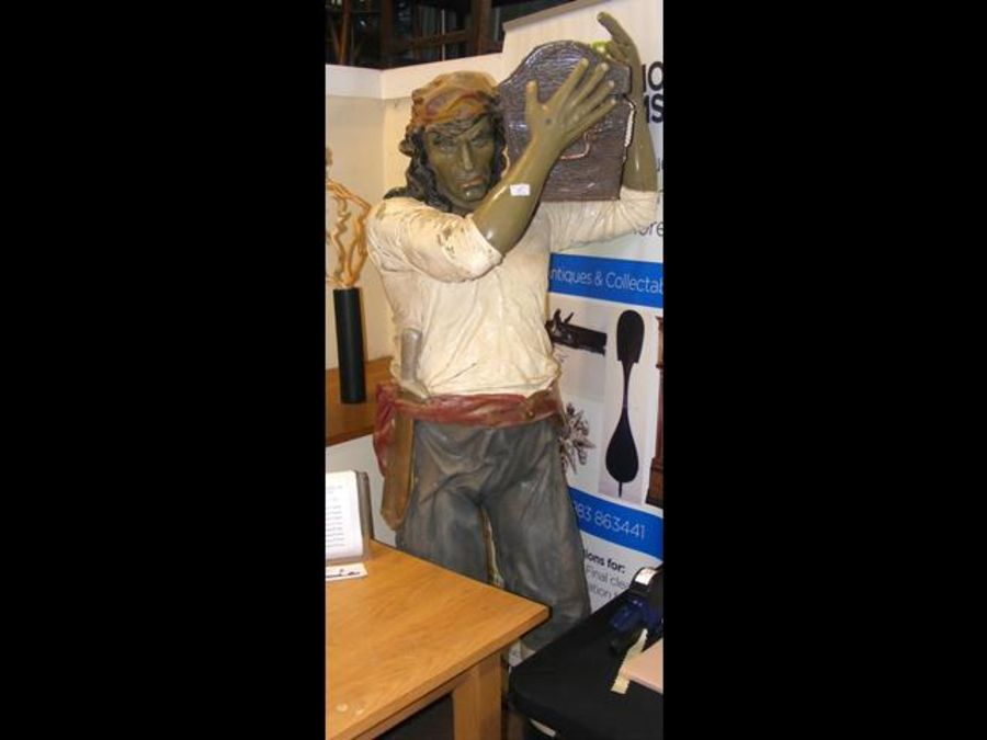 A life size fibreglass pirate carrying chest