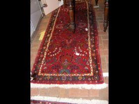A Middle Eastern style runner with geometric borde