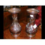 A pair of Oriental bronze vases with relief work d