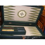 A backgammon set with interesting tapestry base
