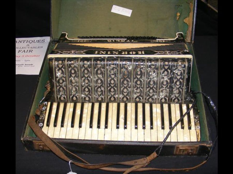 A Borsini piano accordion in fitted carrying case
