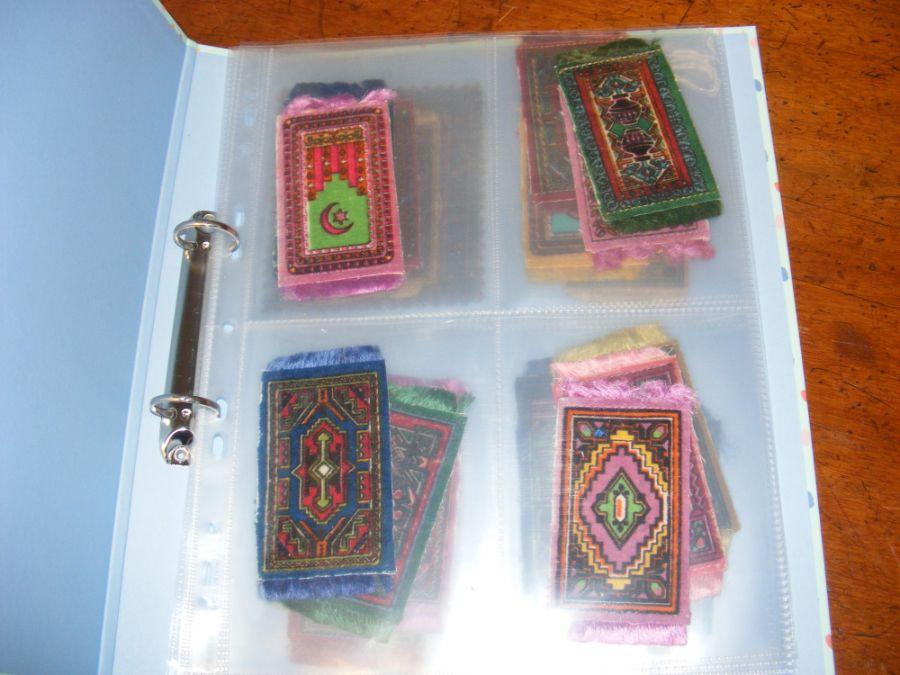 An unusual album of vintage miniature carpet sampl