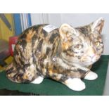 A Winstanley cat ornament with glass eyes - 30cm l