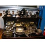 A quantity of silver plated serving ware and cande