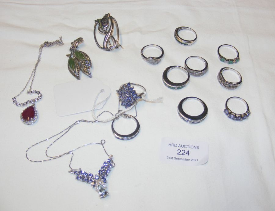 A collection of silver rings and other jewellery