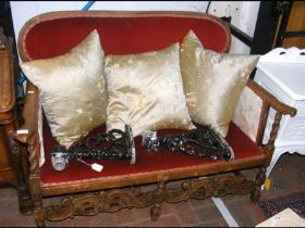 An earlier 20th century two seater settee with woo