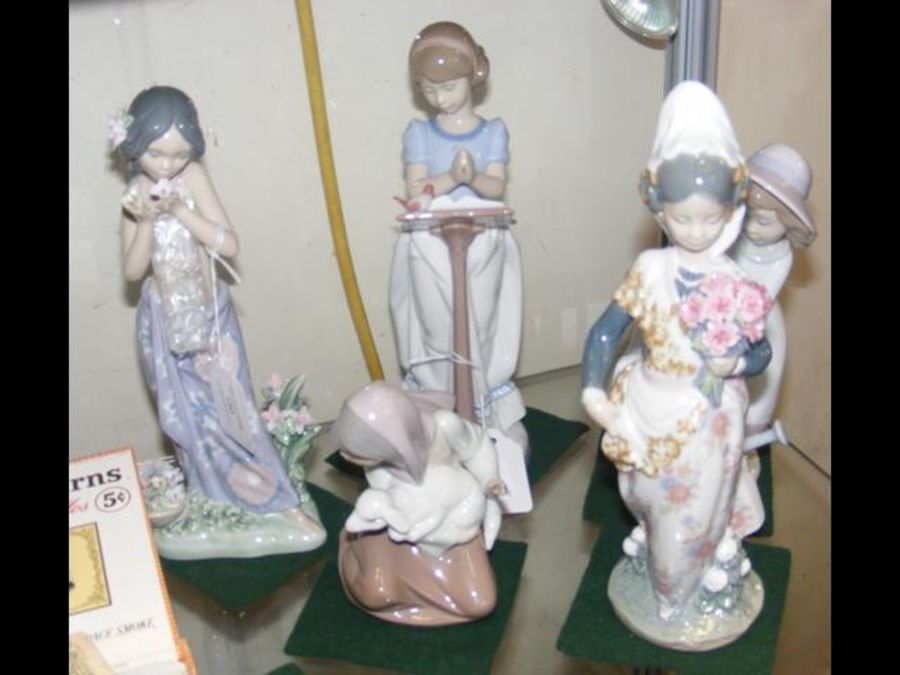 Lladro figures, including Spanish lady with flower