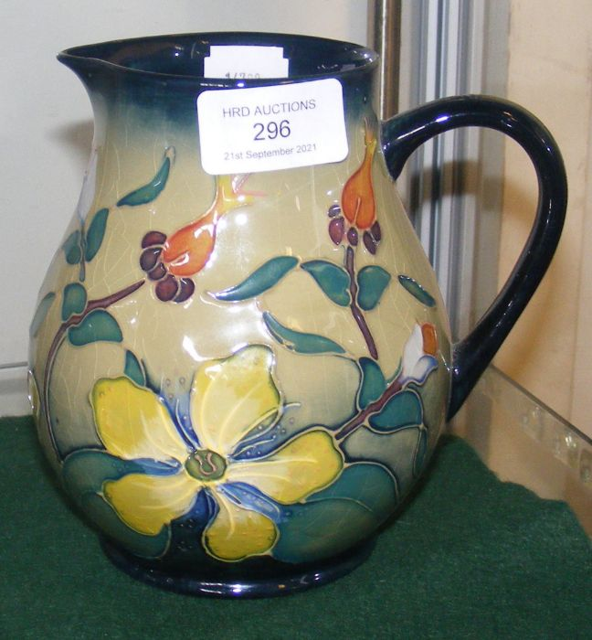 A Moorcroft pottery jug with tube line floral deco