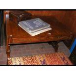 A Regency mahogany sofa table on shaped support an