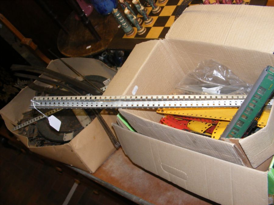 An assortment of vintage Meccano and train track p