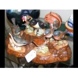 A collection of seven Beswick ceramic birds on 'tr