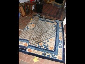 A large Chinese style carpet with geometric border