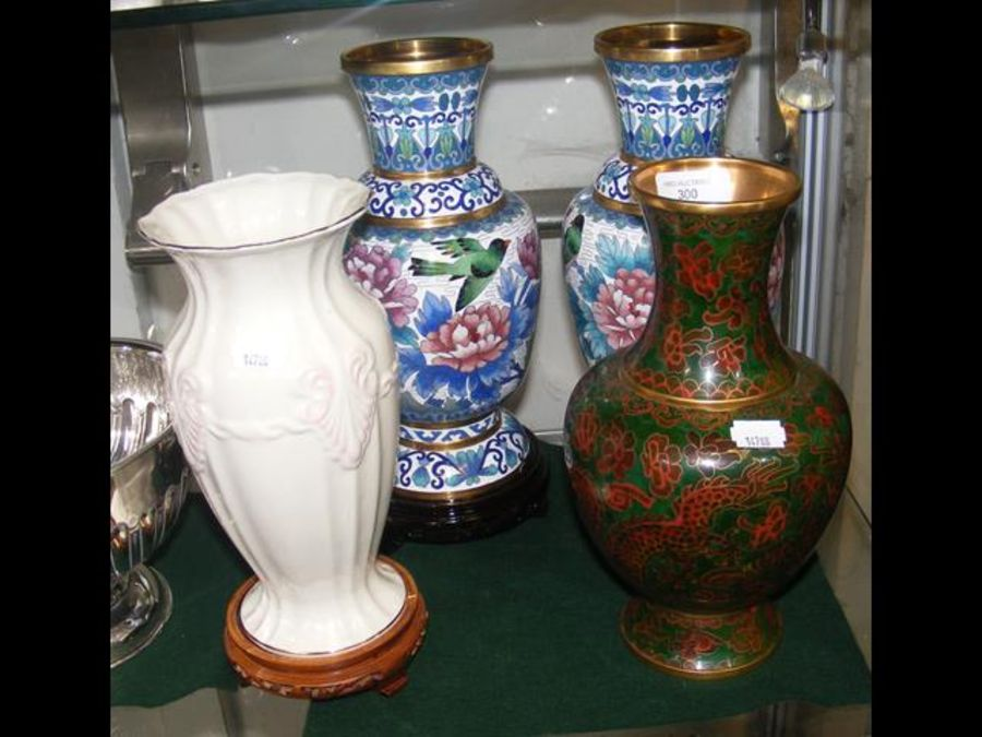 A pair of cloisonne vases, together with one other