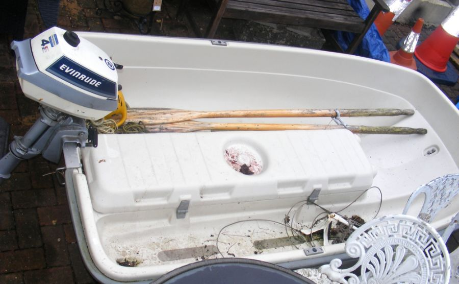 A 7.5ft long two person fibreglass boat with 4HP E