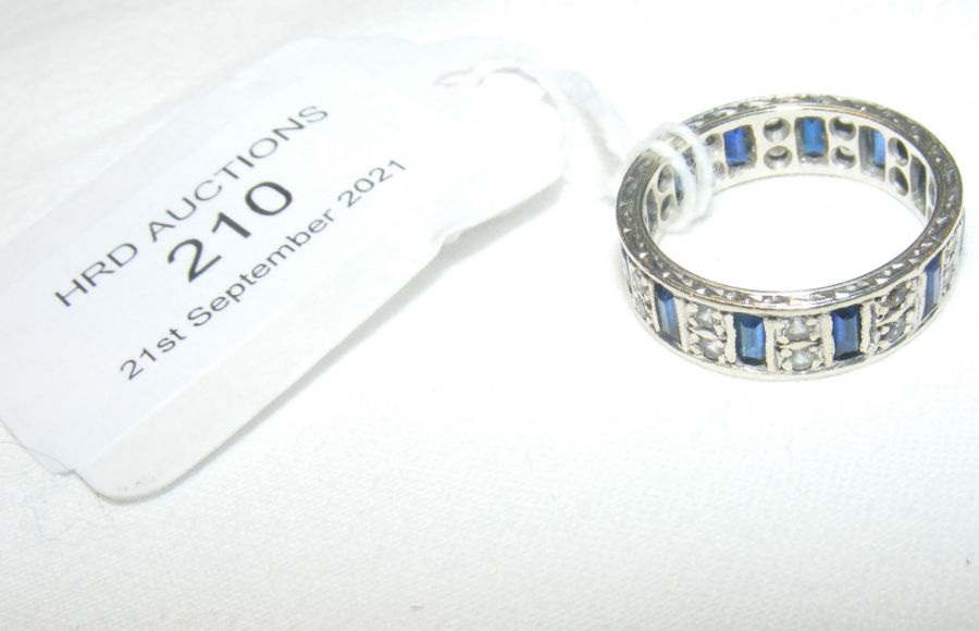 A diamond and sapphire eternity ring