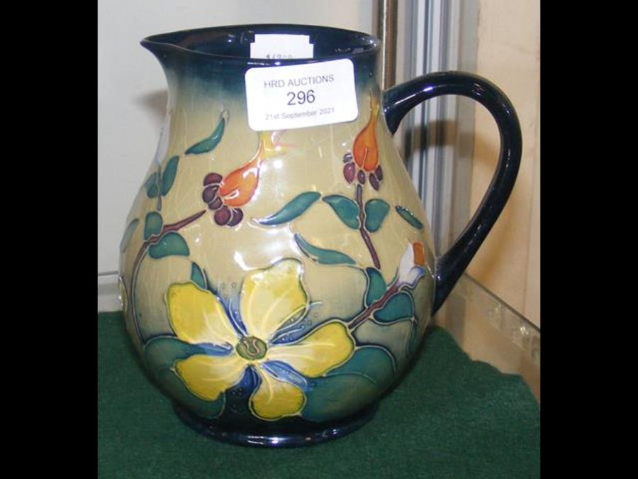 A Moorcroft pottery jug with tube line floral deco - Image 2 of 2