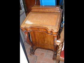A 19th century walnut Davenport desk with four dra