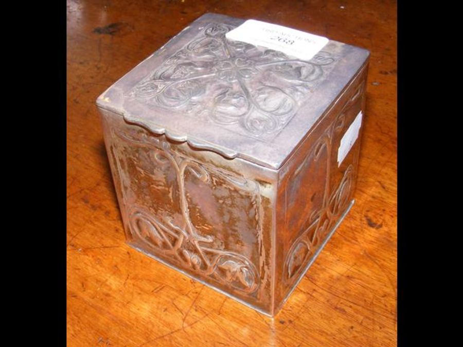 A silver box with Art Nouveau relief work decorati