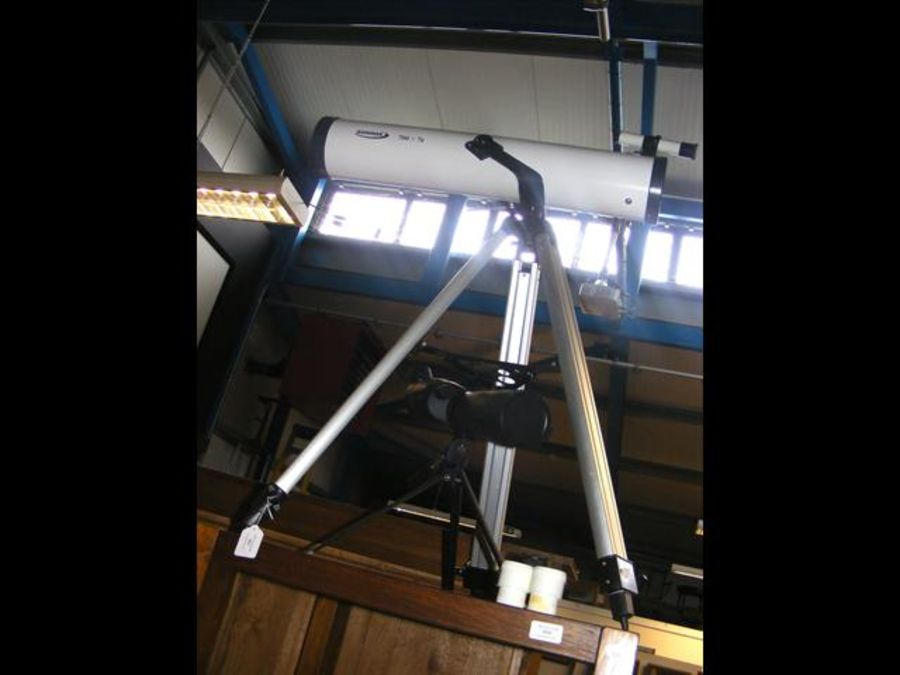 A Zennox 700x76 telescope on stand together with a