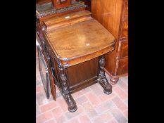 A Victorian mahogany Davenport with stationery com