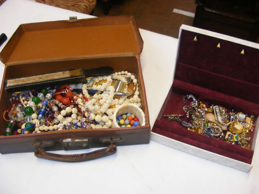 A small case of costume jewellery together with a