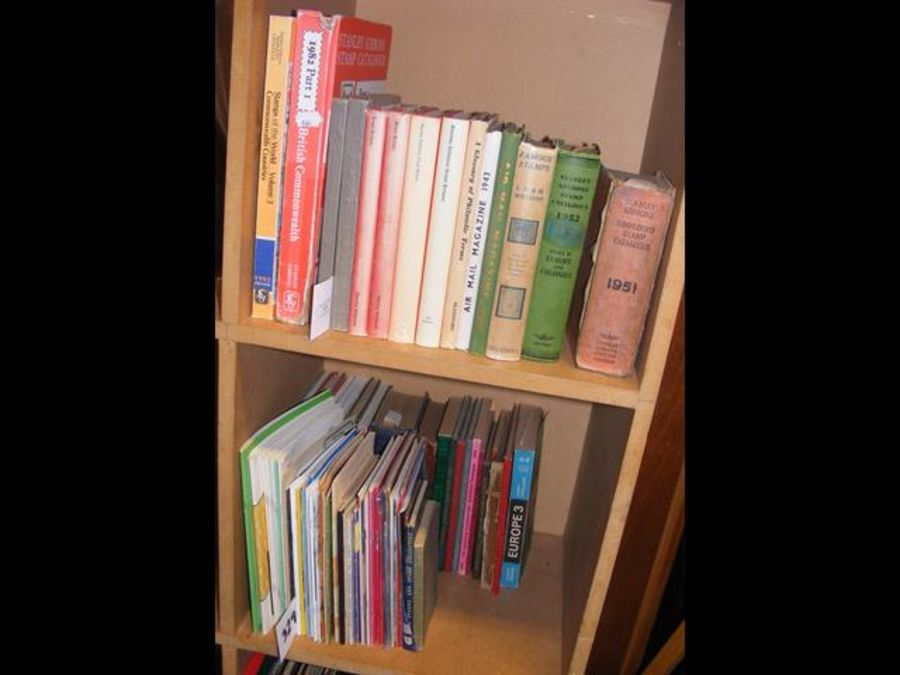 Two cubby-holes of stamp reference books, etc.