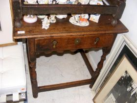 A period oak side table on turned supports