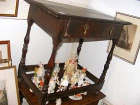 A period side table on turned supports