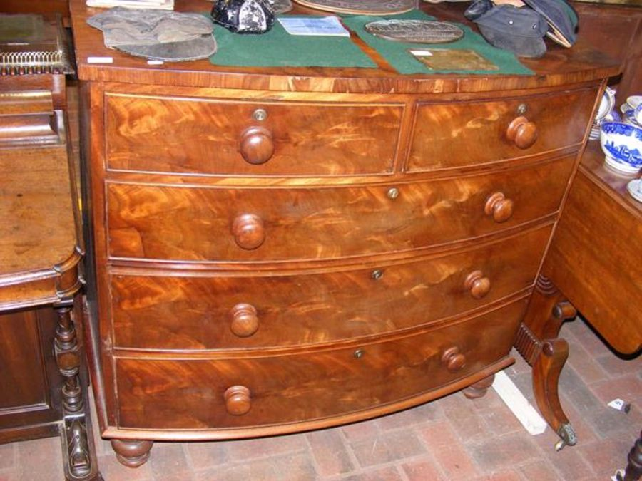 A 19th century mahogany bow front chest of two sho