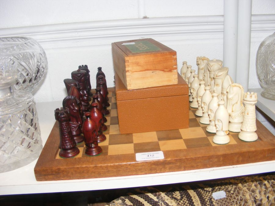 A chess board and character chess pieces, together