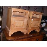 A pair of pine bedside cabinets