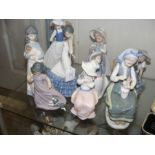 Nine various Lladro and other figurines
