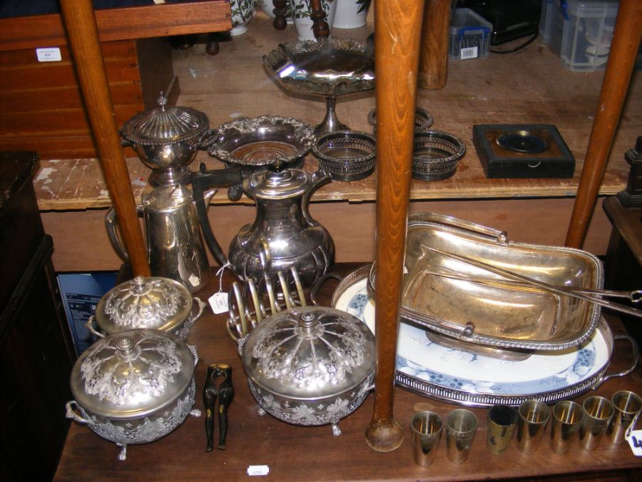 An assortment of silver plated serving ware