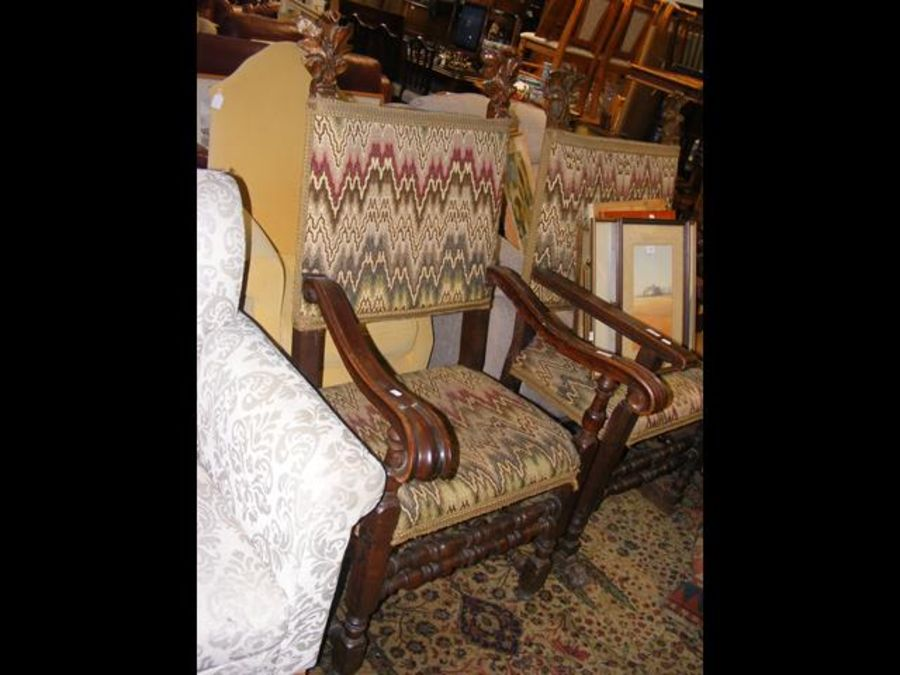 An antique armchair on turned supports