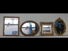Four various wall mirrors