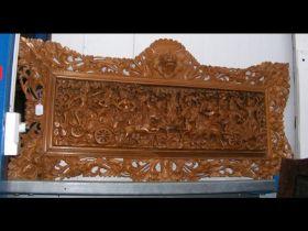 A carved wooden plaque - 140cm x 70cm