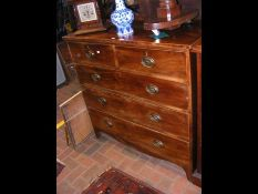 A 19th century mahogany chest of two short and thr