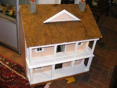 A doll's house with tiled roof and veranda - width