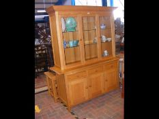 A modern light wood display cabinet with glazed up