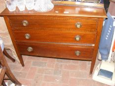 An Edwardian chest of drawers