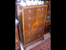 A 1920's chest of five long drawers